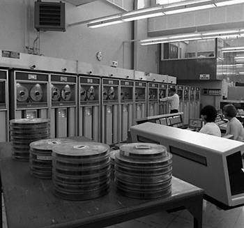 Census computing, 1966 - an office with computer reels in foreground, and banks of computers