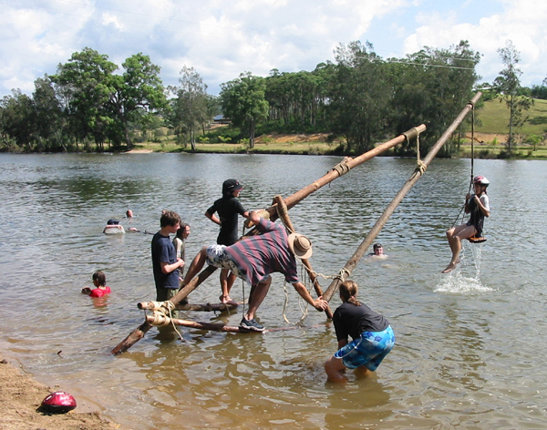 Photograph: Scouts have fun on a dunking machine they constructed – courtesy Maren Child.