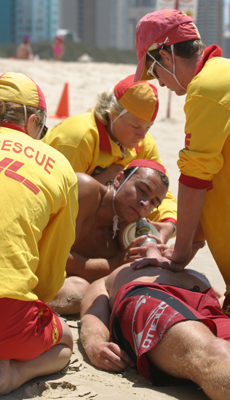 Queensland surf lifesavers undertaking CPR -- courtesy Harvie Allison.