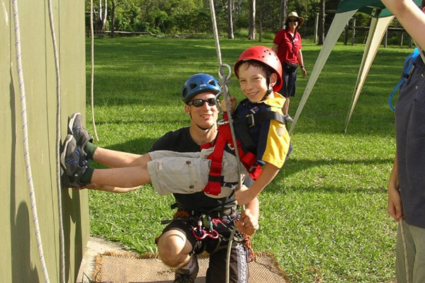 Photograph: Cub Scout and leader abseiling – courtesy Nick Politylo.