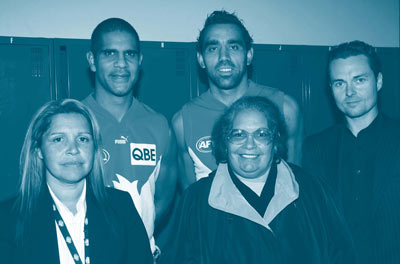 Michael O'Loughlin and Adam Goodes from the Sydney Swans at the Sydney Cricket Ground, with ABS staff: Indigenous Engagement Manager, Glenda Roberts; Statistical Coordination (Indigenous officer), Gloria Strachan; and Census PR Manager (NSW), And