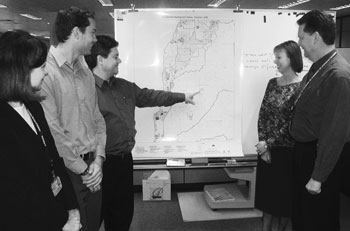 Image: Staff from the ASB SA Office reviewing maps for the 2006 Census of Population and Housing dress rehearsal held in August 2005