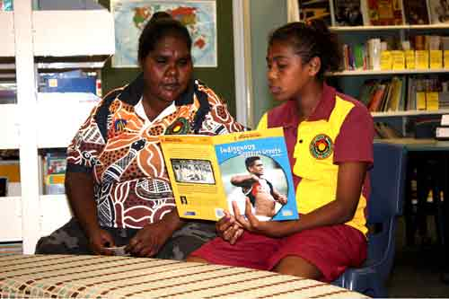 Image: Cherbourg girl reading with elder.