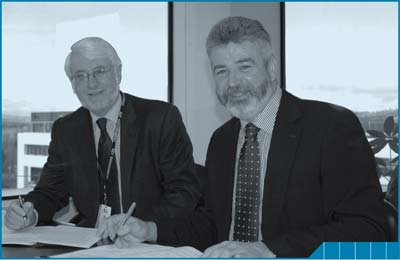 Brian Pink and Andrew Cappie-Wood sign the ACT IDP in June, 2008