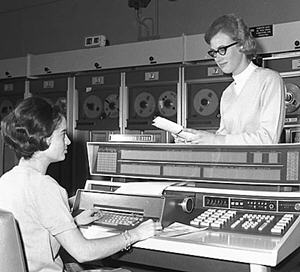 Two women staff in the computing room