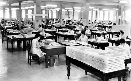 Photograph of the coding floor in 1966 showing many women sitting at rows of desks coding census forms