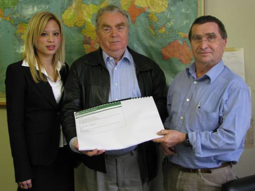 Picture: Valdis Juskevics and Jennie Dunn (ABS ACT office) present the information consultancy report to Dr James Jupp