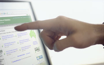 A hand points at a computer screen showing the Census Home Page, 2006 Census